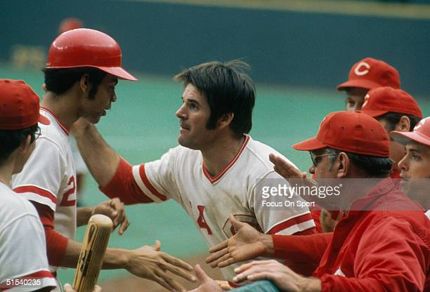 Outfielder Pete Rose congratulates Cesar Geronimo of the Cincinnati Reds after a big hit at Riverfront Stadium during the 1970s in Cincinnati Ohio