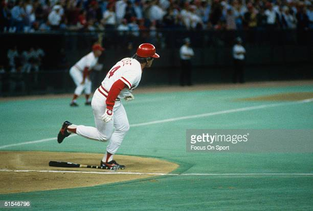 Outfielder Pete Rose of the Cincinnati Reds runs to first base after connecting for his 4192 career hit making him baseball's all time hits leader...