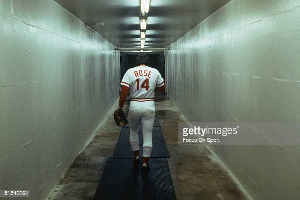 Outfielder Pete Rose of the Cincinnati Reds walks alone down a vacant corridor at Riverfront Stadium during the 1970s in Cincinnati Ohio