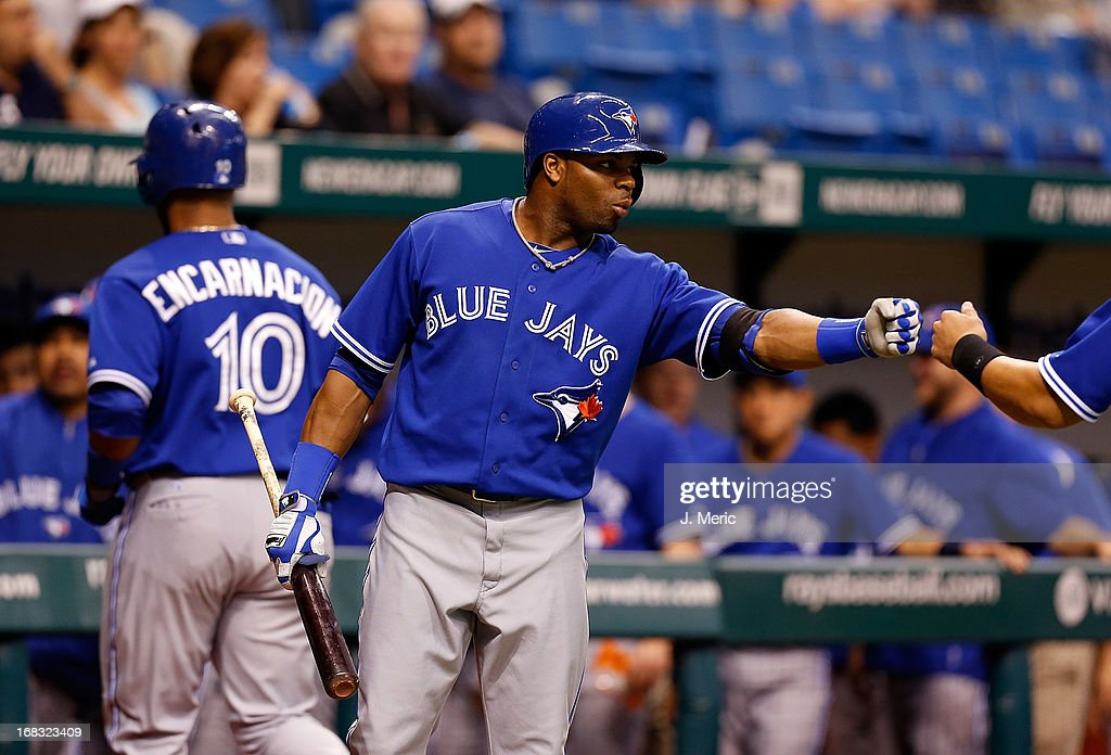 Outfielder <a gi-track='captionPersonalityLinkClicked' href=/galleries/search?phrase=Rajai+Davis&family=editorial&specificpeople=810608 ng-click='$event.stopPropagation()'>Rajai Davis</a> #11 of the Toronto Blue Jays celebrates a first inning run against the Tampa Bay Rays at Tropicana Field on May 8, 2013 in St. Petersburg, Florida.
