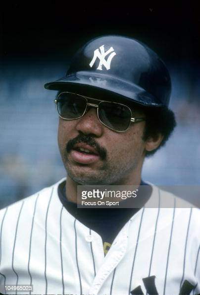 outfielder-reggie-jackson-of-the-new-york-yankees-looks-on-during-a-picture-id104965023?s=594x594