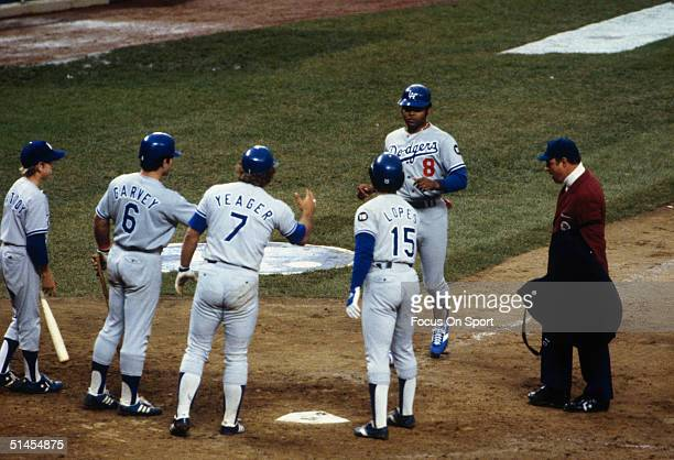 Outfielder Reggie Smith of the Los Angeles Dodgers is greeted at home plate after his three run homer during the World Series against the New York...