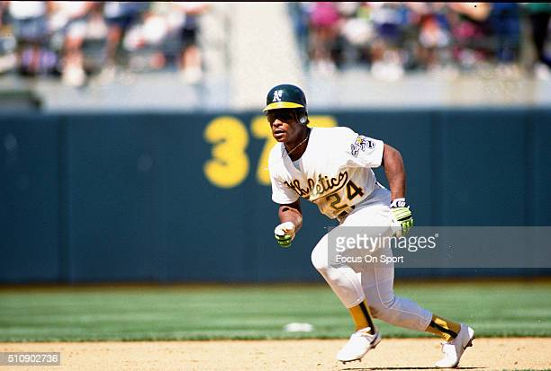 Outfielder Rickey Henderson of the Oakland Athletics leads off of second base during an Major League Baseball game circa 1991 at the OaklandAlameda...