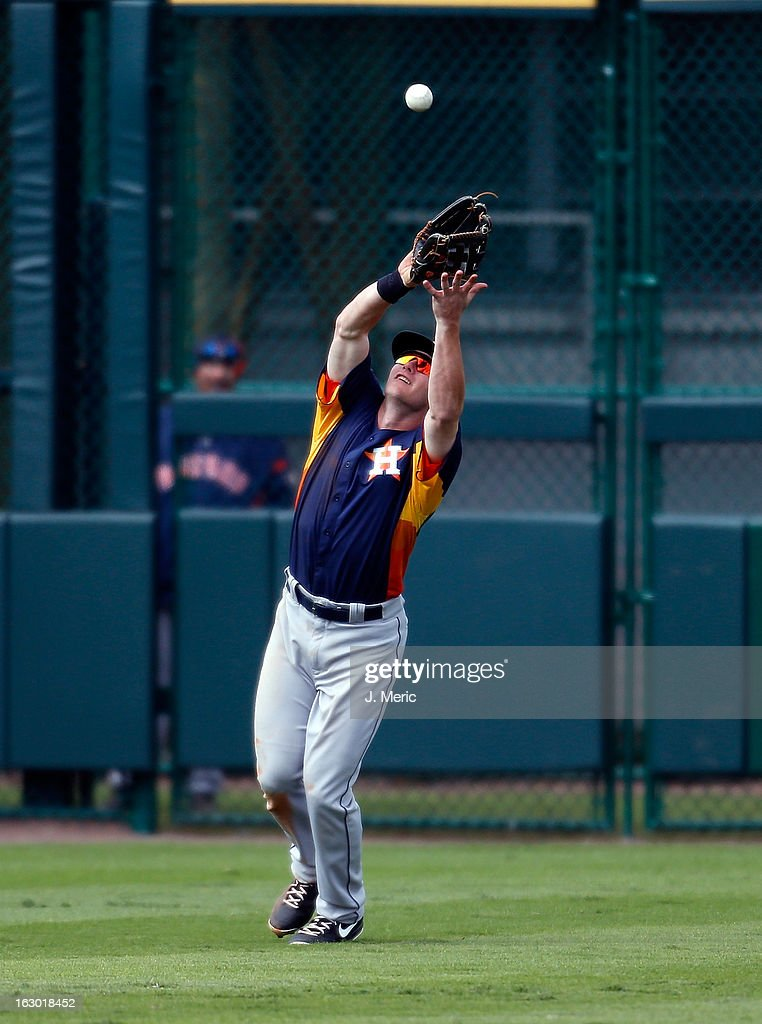 Outfielder Robbie Grossman #78 of the Houston Astros catches a fly ball against the Pittsburgh Pirates during a Grapefruit League Spring Training Game at McKechnie Field on March 3, 2013 in Bradenton, Florida.