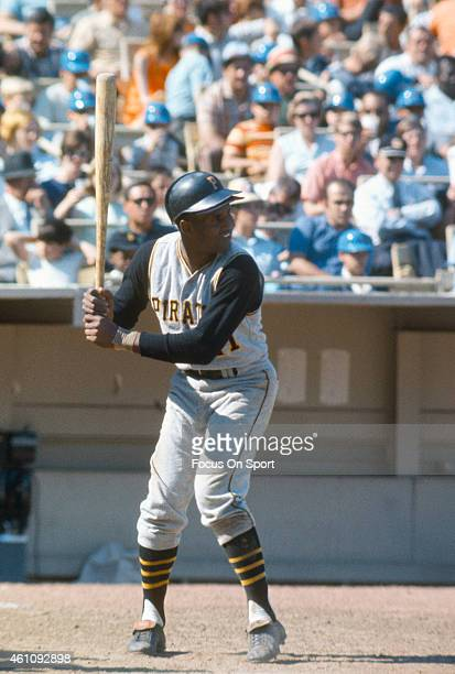 Outfielder Roberto Clemente' #21of Pittsburgh Pirates bats against the New York Mets during an Major League Baseball game circa 1965 at Shea Stadium...