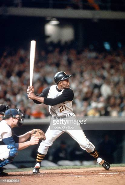 Outfielder Roberto Clemente' #21of Pittsburgh Pirates bats against the Los Angeles Dodgers during an Major League Baseball game circa 1965 at Dodger...