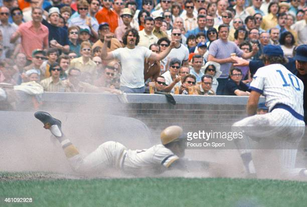 Outfielder Roberto Clemente' #21of Pittsburgh Pirates dives back into first base safe against the Chicago Cubs during an Major League Baseball game...