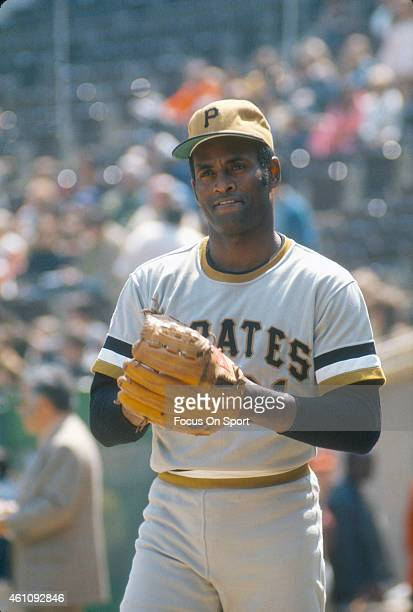 Outfielder Roberto Clemente' #21of Pittsburgh Pirates warms up playing catch prior to the start of a Major League Baseball game circa 1970 Clemente'...