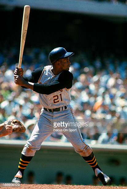 Outfielder Roberto Clemente' of Pittsburgh Pirates bats against the Los Angeles Dodgers during an Major League Baseball game circa 1965 at Dodger...