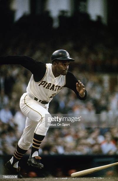 Outfielder Roberto Clemente Pittsburgh Pirates sprints out of the batters box after putting the ball in play during a MLB baseball game circa early...