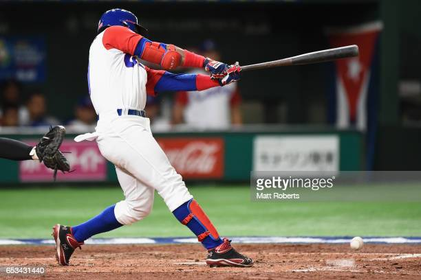 Outfielder Roel Santos of Cuba grournds out in the bottom of the third inning during the World Baseball Classic Pool E Game Five between Netherlands...