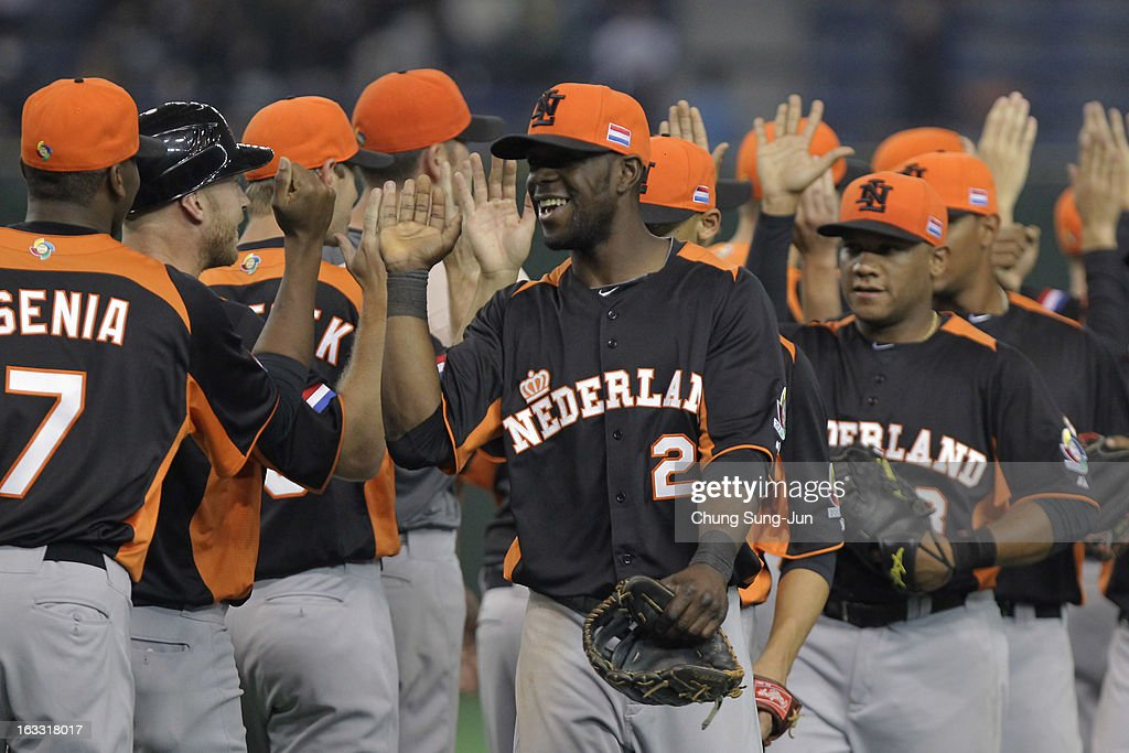 Outfielder Roger Bernadina # 2 and his team mates celebrate victory over Cuba in the World Baseball Classic Second Round Pool 1 game between the Netherlands and Cuba at Tokyo Dome on March 8, 2013 in Tokyo, Japan.