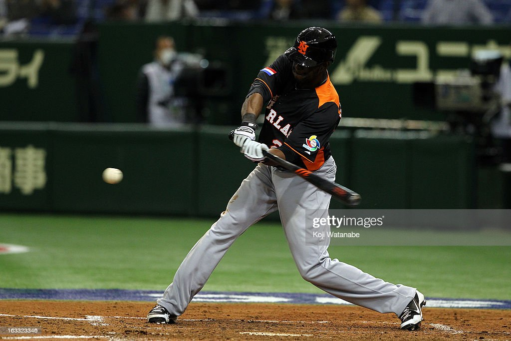 Outfielder <a gi-track='captionPersonalityLinkClicked' href=/galleries/search?phrase=Roger+Bernadina&family=editorial&specificpeople=4246414 ng-click='$event.stopPropagation()'>Roger Bernadina</a> #2 of the Netherlands at bat during the World Baseball Classic Second Round Pool 1 game between the Netherland and Cuba at Tokyo Dome on March 8, 2013 in Tokyo, Japan.