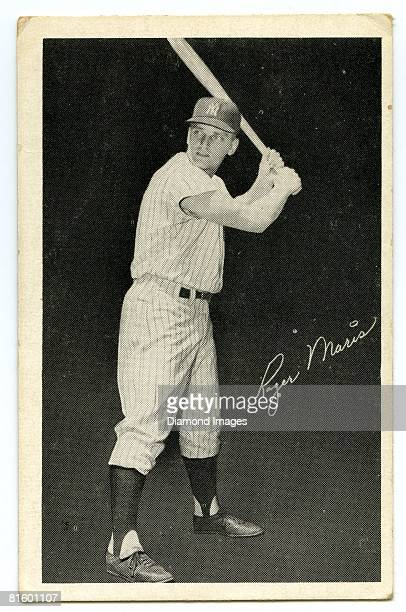 Outfielder Roger Maris of the New York Yankees is pictured on one side of the game cards for a baseball card game from 1962 sold at Yankee Stadium in...