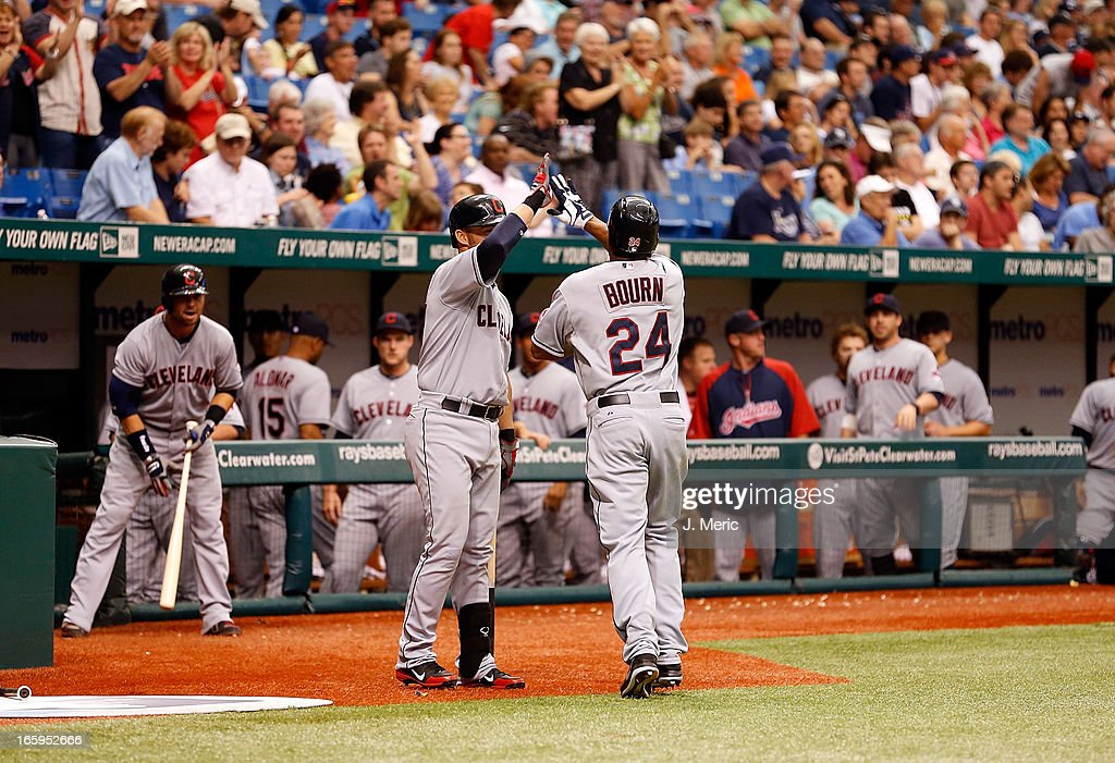 Outfielder Ryan Raburn #9 of the Cleveland Indians congratulates Michael Bourn #24 after he scorred against the Tampa Bay Rays during the game at Tropicana Field on April 7, 2013 in St. Petersburg, Florida.
