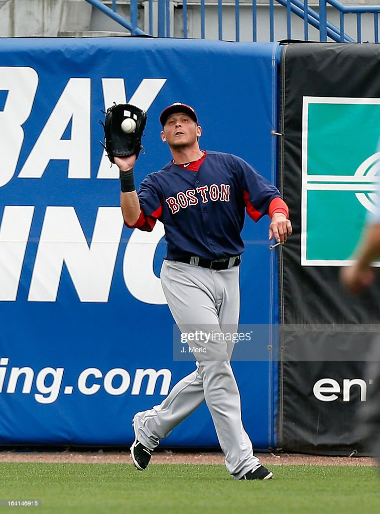 Outfielder <a gi-track='captionPersonalityLinkClicked' href=/galleries/search?phrase=Ryan+Sweeney+-+Baseball+Player&family=editorial&specificpeople=711121 ng-click='$event.stopPropagation()'>Ryan Sweeney</a> #25 of the Boston Red Sox catches a fly ball against the New York Yankees during a Grapefruit League Spring Training Game at George M. Steinbrenner Field on March 20, 2013 in Tampa, Florida.