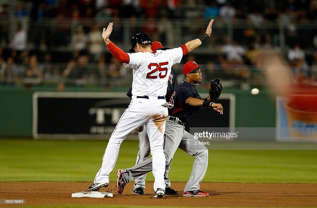 Outfielder <a gi-track='captionPersonalityLinkClicked' href=/galleries/search?phrase=Ryan+Sweeney&family=editorial&specificpeople=711121 ng-click='$event.stopPropagation()'>Ryan Sweeney</a> #25 of the Boston Red Sox is safe at second as shortstop Pedro Florimon #25 of the Minnesota Twins throws over to first during a Grapefruit League Spring Training Game at JetBlue Park on March 8, 2013 in Fort Myers, Florida.