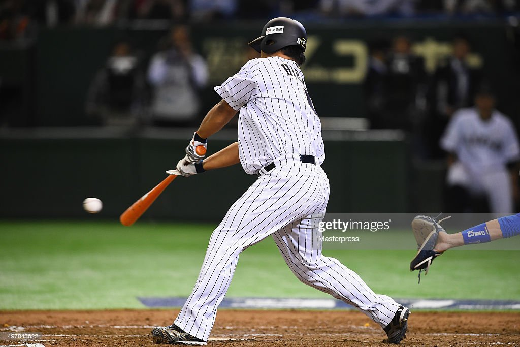 outfielder Ryosuke Hirata #8 of Japan hits a RBI single in the bottom of fourth inning during the WBSC Premier 12 semi final match between South Korea and Japan at the Tokyo Dome on November 19, 2015 in Tokyo, Japan.