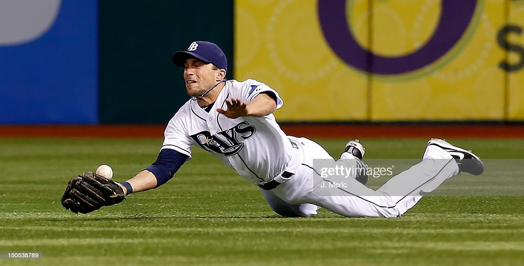 Outfielder Sam Fuld #5 of the Tampa Bay Rays cannot come up with this fly ball against the Kansas City Royals during the game at Tropicana Field on August 20, 2012 in St. Petersburg, Florida.