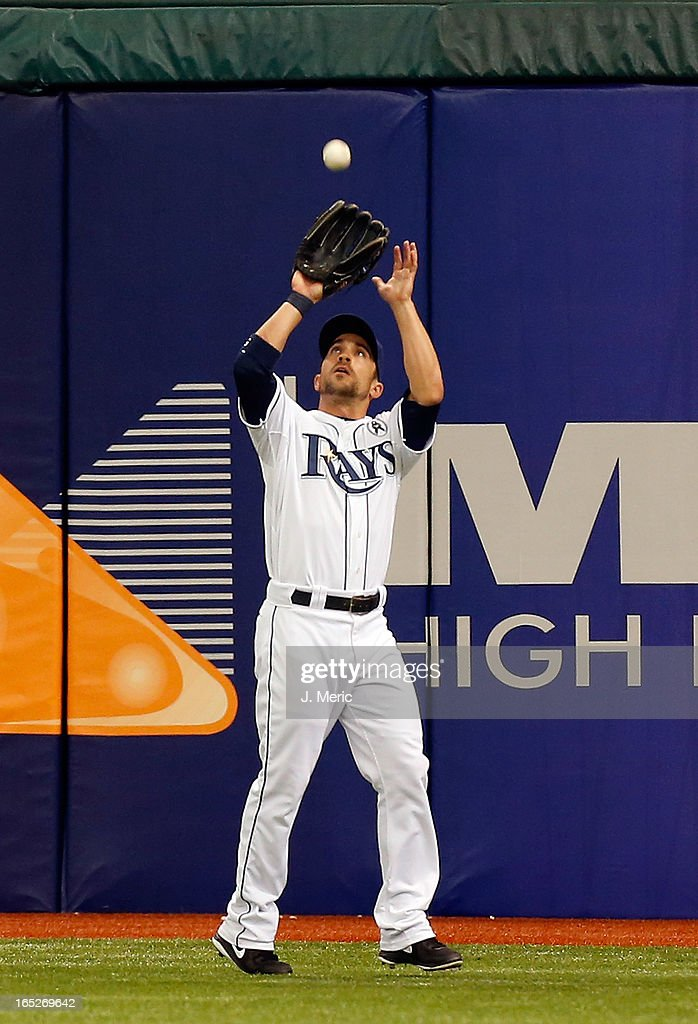 Outfielder Sam Fuld #5 of the Tampa Bay Rays catches a first inning fly ball against the Baltimore Orioles during the Opening Day game at Tropicana Field on April 2, 2013 in St. Petersburg, Florida.