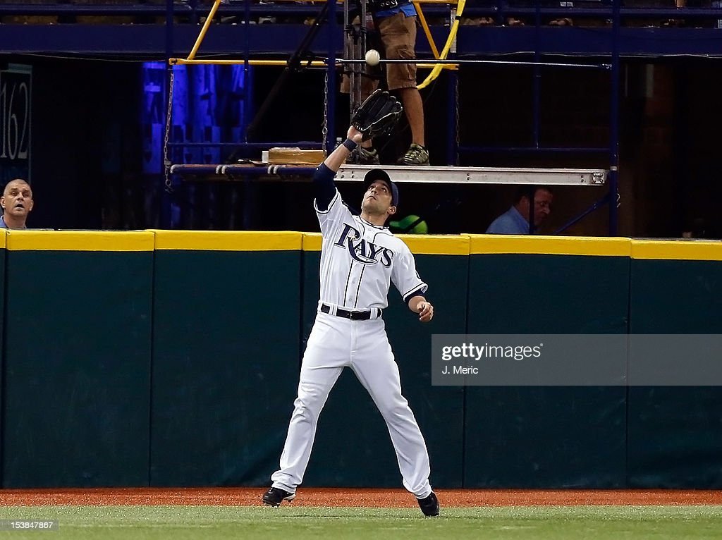 Outfielder Sam Fuld #5 of the Tampa Bay Rays catches a fly ball against the Baltimore Orioles during the game at Tropicana Field on October 3, 2012 in St. Petersburg, Florida.