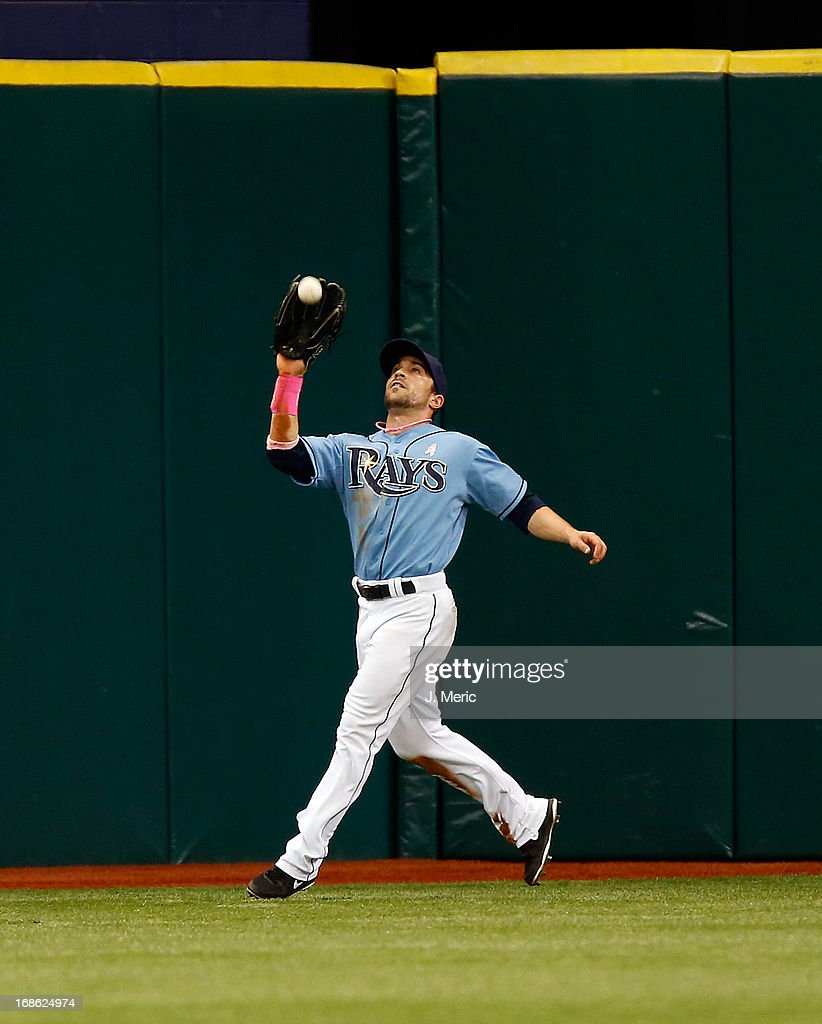 Outfielder Sam Fuld #5 of the Tampa Bay Rays catches a fly ball against the San Diego Padres during the game at Tropicana Field on May 12, 2013 in St. Petersburg, Florida.