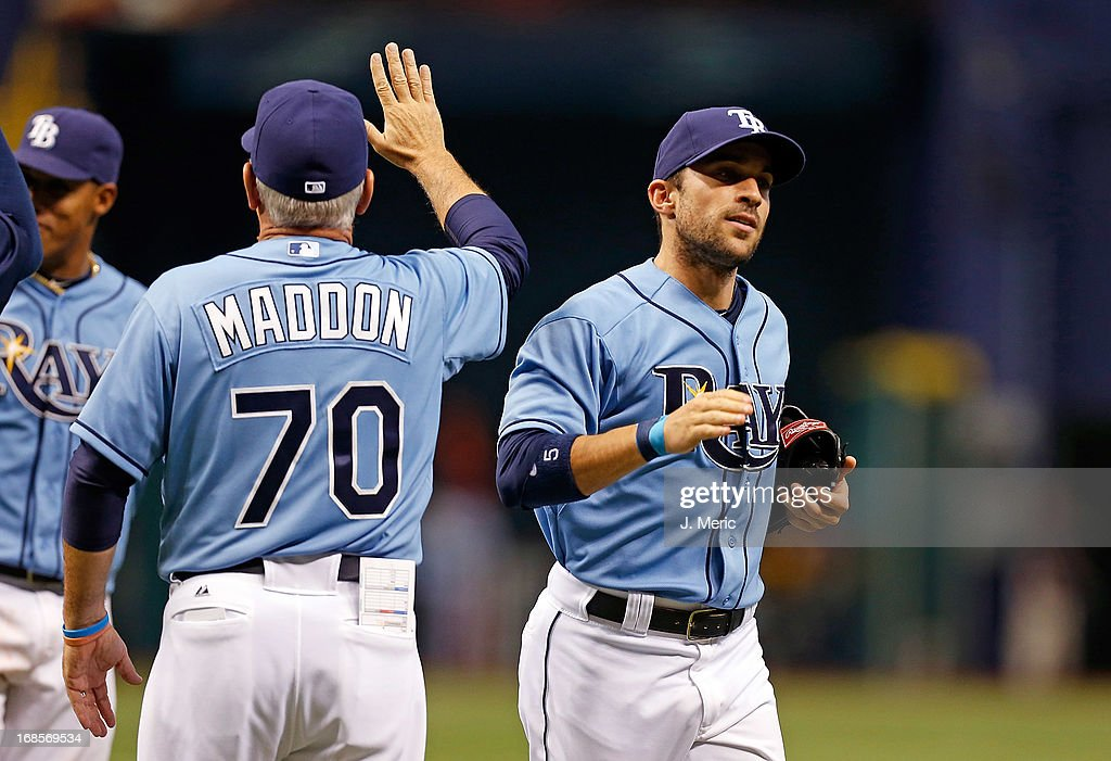 Outfielder Sam Fuld of the Tampa Bay Rays is congratulaged after the victory over the Oakland Athletics at Tropicana Field on April 21, 2013 in St. Petersburg, Florida.