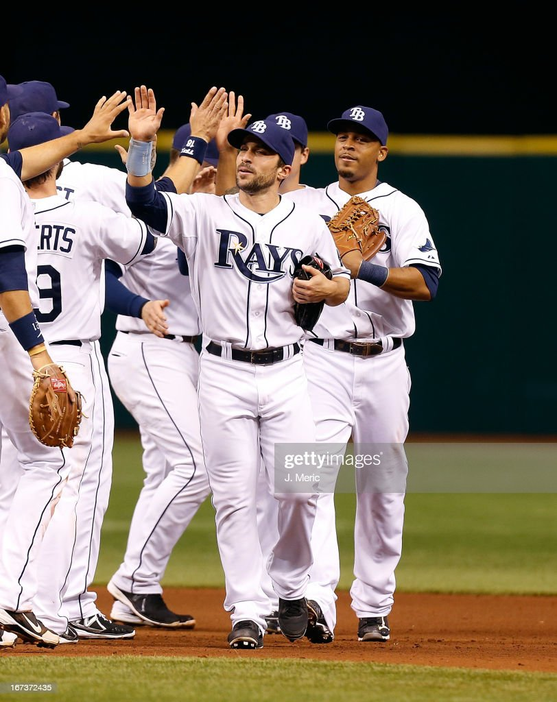 Outfielder <a gi-track='captionPersonalityLinkClicked' href=/galleries/search?phrase=Sam+Fuld&family=editorial&specificpeople=4505687 ng-click='$event.stopPropagation()'>Sam Fuld</a> #5 of the Tampa Bay Rays is congratulated after the Rays victory over the New York Yankees at Tropicana Field on April 24, 2013 in St. Petersburg, Florida.