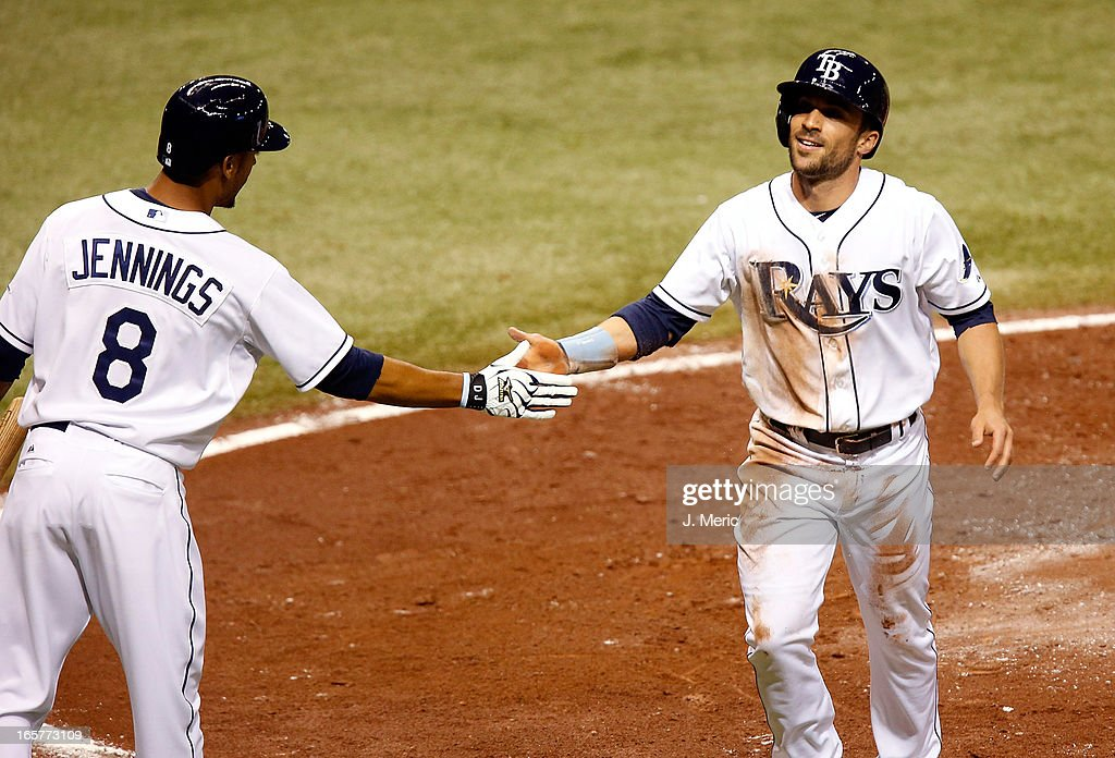 Outfielder Sam Fuld #5 of the Tampa Bay Rays is congratulated by Desmond Jennings #8 after scoring against the Cleveland Indians during the game at Tropicana Field on April 5, 2013 in St. Petersburg, Florida.