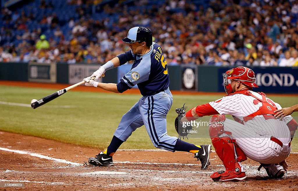 Outfielder <a gi-track='captionPersonalityLinkClicked' href=/galleries/search?phrase=Sam+Fuld&family=editorial&specificpeople=4505687 ng-click='$event.stopPropagation()'>Sam Fuld</a> #5 of the Tampa Bay Rays singles in a run in the sixth inning against the Chicago White Sox during the game at Tropicana Field on July 6, 2013 in St. Petersburg, Florida.