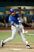 Outfielder Sammy Sosa of the Chicago Cubs singles against the Florida Marlins in game three of the National League Championship Series on October 10...