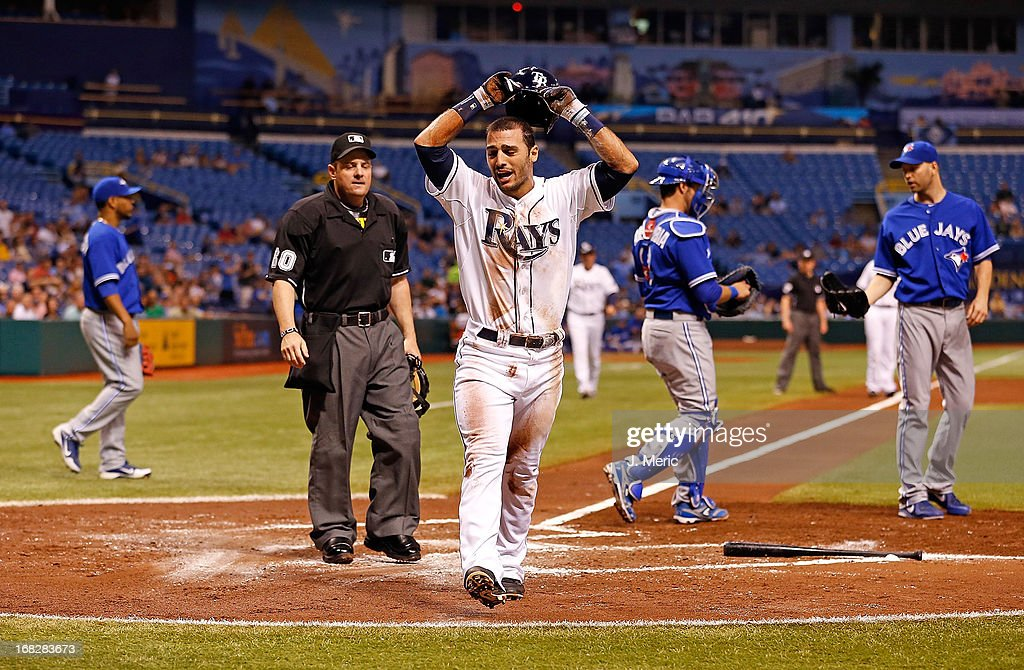 Outfielder <a gi-track='captionPersonalityLinkClicked' href=/galleries/search?phrase=Sean+Rodriguez&family=editorial&specificpeople=4171805 ng-click='$event.stopPropagation()'>Sean Rodriguez</a> #1 of the Tampa Bay Rays is upset after he is called out at home against the Toronto Blue Jays during the game at Tropicana Field on May 7, 2013 in St. Petersburg, Florida.