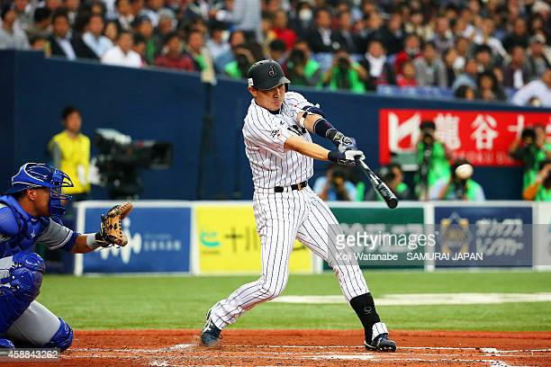 Outfielder Seiichi Uchikawa hits a single during in the top of the second inning the game one of Samurai Japan and MLB All Stars at Kyocera Dome...