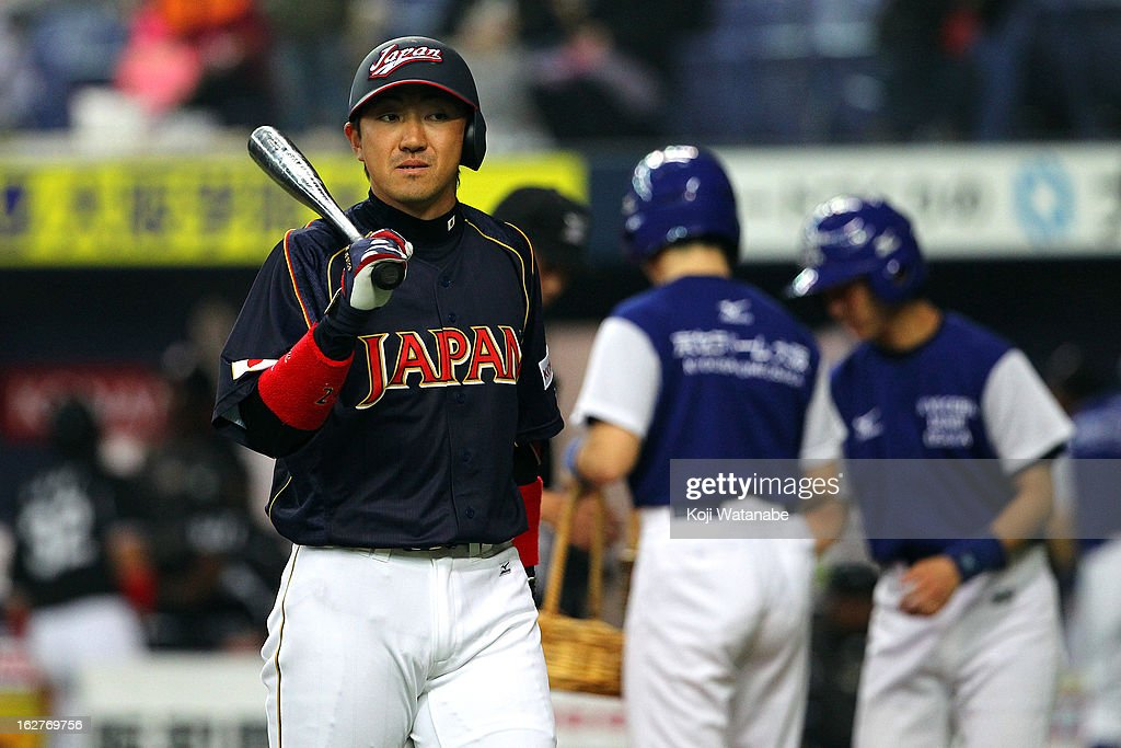 Outfielder Seiichi Uchikawa #24 in action during the friendly game between Hanshin Tigers and Japan at Kyocera Dome Osaka on February 26, 2013 in Osaka, Japan.