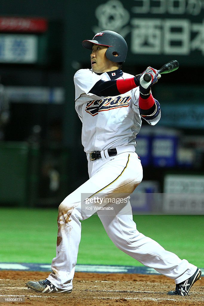 Outfielder <a gi-track='captionPersonalityLinkClicked' href=/galleries/search?phrase=Seiichi+Uchikawa&family=editorial&specificpeople=5739573 ng-click='$event.stopPropagation()'>Seiichi Uchikawa</a> #24 of Japan at bat during the World Baseball Classic First Round Group A game between Japan and China at Fukuoka Yahoo! Japan Dome on March 3, 2013 in Fukuoka, Japan.