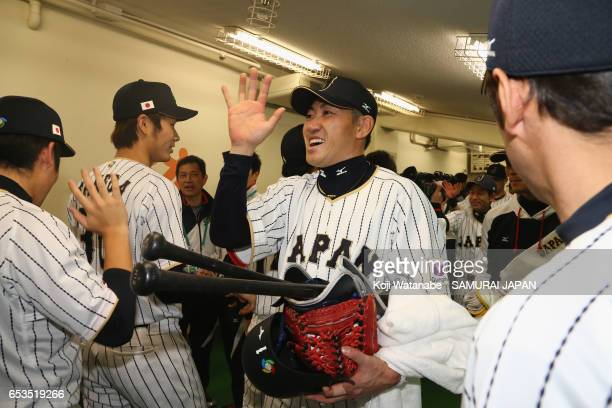 Outfielder Seiichi Uchikawa of Japan celebrates winning after the World Baseball Classic Pool E Game Six between Israel and Japan at the Tokyo Dome...