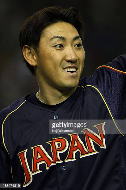 Outfielder Seiichi Uchikawa of Japan celerates victory during the World Baseball Classic Second Round Pool 1 game between Japan and the Netherlands...