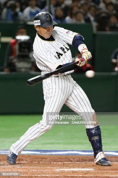 Outfielder Seiichi Uchikawa of Japan hits a grounder in the bottom of the third inning during the World Baseball Classic Pool E Game Six between...