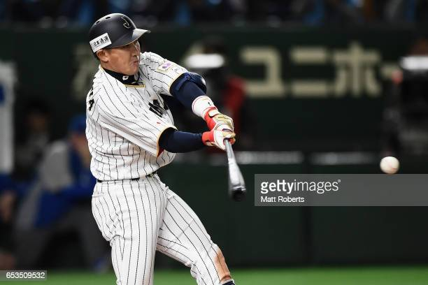 Outfielder Seiichi Uchikawa of Japan hits a RBI double to make it 07 in the bottom of the eighth inning during the World Baseball Classic Pool E Game...