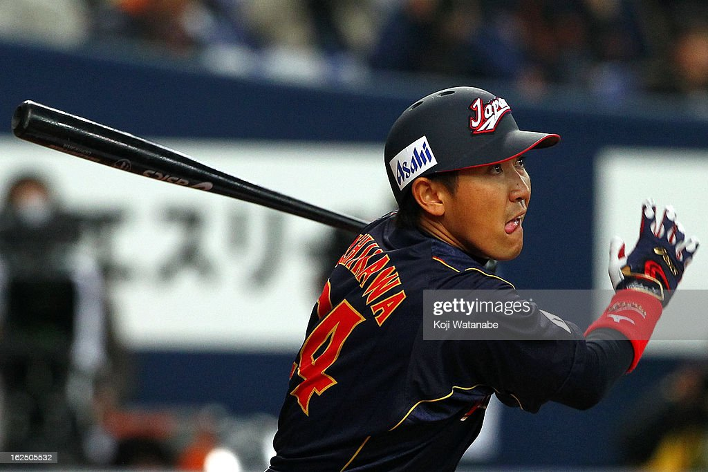 Outfielder Seiichi Uchikawa #24 of Japan hits a RBI single in the bottom half of the first inning during the international friendly game between Australia and Japan at Kyocera Dome Osaka on February 24, 2013 in Osaka, Japan.