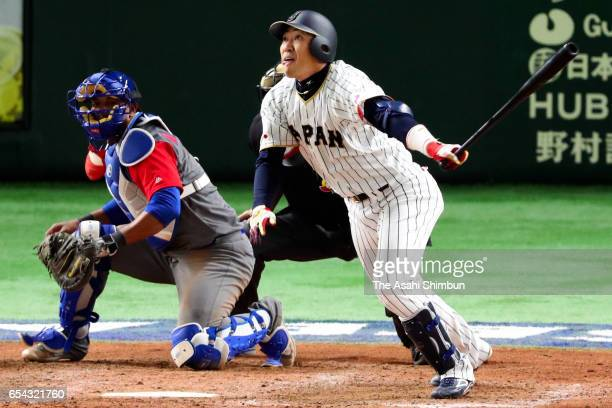 Outfielder Seiichi Uchikawa of Japan hits a sacrifice fly to make it 56 in the bottom of the eighth inning during the World Baseball Classic Pool E...