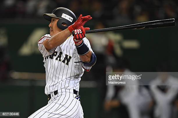 Outfielder Seiichi Uchikawa of Japan hits a single in the eighth inning during the international friendly match between Japan and Mexico at the Tokyo...