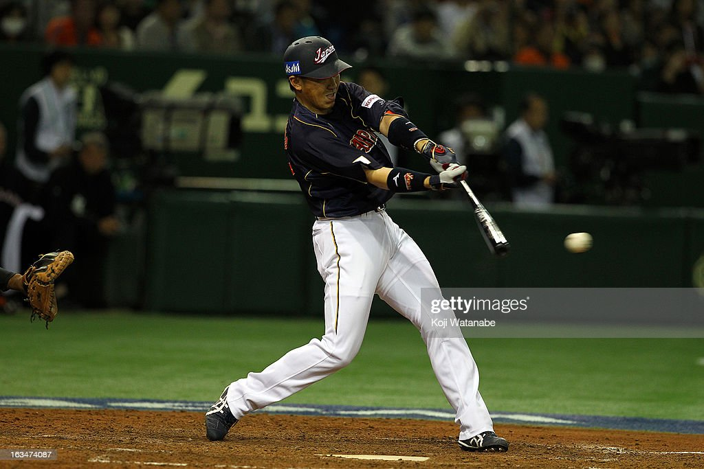 Outfielder Seiichi Uchikawa #24 of Japan hits a three-run home run in the bottom of the second inning during the World Baseball Classic Second Round Pool 1 game between Japan and the Netherlands at Tokyo Dome on March 10, 2013 in Tokyo, Japan.