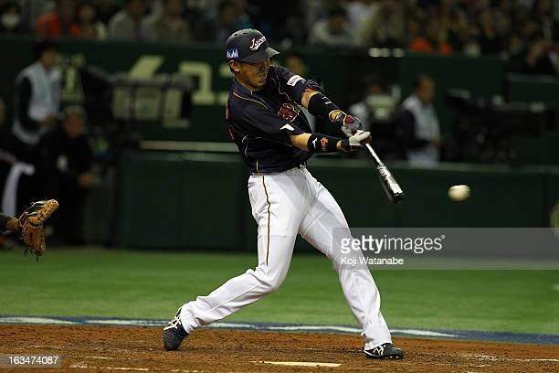 Outfielder Seiichi Uchikawa of Japan hits a threerun home run in the bottom of the second inning during the World Baseball Classic Second Round Pool...