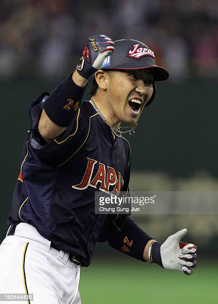 Outfielder Seiichi Uchikawa of Japan reacts after hits three run home run top of the second inning during the World Baseball Classic Second Round...