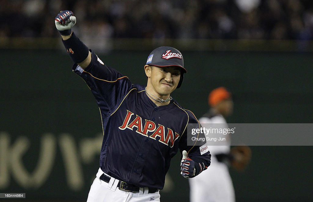 Outfielder Seiichi Uchikawa # 24 of Japan reacts after hits three run home run top of the second inning during the World Baseball Classic Second Round Pool 1 game between Japan and the Netherlands at Tokyo Dome on March 10, 2013 in Tokyo, Japan.