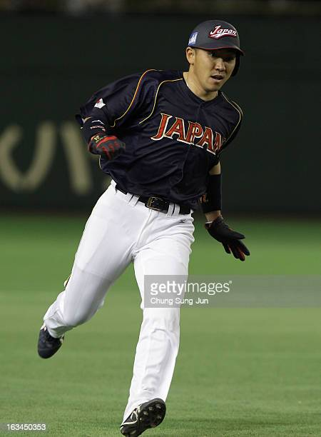 Outfielder Seiichi Uchikawa of Japan runs into third base during the World Baseball Classic Second Round Pool 1 game between Japan and the...