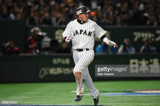 Outfielder Seiichi Uchikawa of Japan scores a run by a RBI single of Infielder Nobuhiro Matsuda to make it 08 in the bottom of the eighth inning...