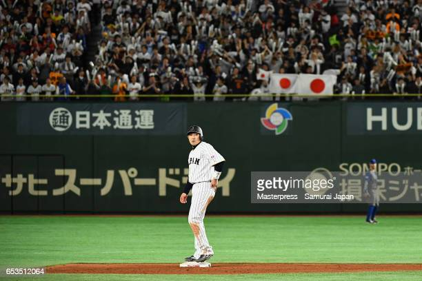 Outfielder Seiichi Uchikawa of Japan stands on the second base after hitting a RBI double to make it 07 in the bottom of the eighth inning during the...