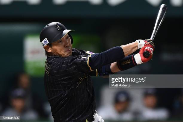 Outfielder Seiichi Uchikawa of Japan swings in the top of the first inning during the SAMURAI JAPAN Sendoff Friendly Match between CPBL Selected Team...
